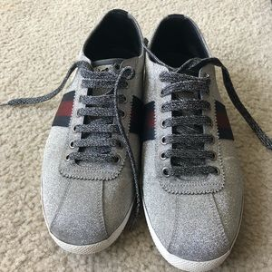 Glitter web sneakers with studs.